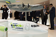 A scale model of the Airbus E-Fan X and A400M transporter aircraft and Airbus employees in the companys hospitality chalet at the Farnborough Airshow, on 18th July 2018, in Farnborough, England. The Airbus E-Fan is a prototype two-seater electric aircraft that was under development by Airbus.