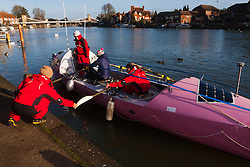 Marlow, Bucks, January 24th 2015. Olympic and Paralympic rowing medallists including Naomi Riches, Heather Stanning and Katherine Grainger join members of a Coxless Crew at Marlow at their boat naming ceremony. The Coxless Crew is a team of four women who have given up their jobs to undertake an epic six-month 8,446 mile adventure rowing their boat Doris across the Pacific ocean from Sanfrancisco to Cairns in Australia, to raise funds for charities Walking With The Wounded and Breast Cancer Care. PICTURED: Natalia Cohen of the Coxless Crew helps crewmates Laura Penhaul and Emma Mitchell to bring Doris alongside after taking Olympic gold medallist Heather Stanning for a short row on the Thames.