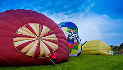 Strathaven Scotland UK 27th August 2016 - The Strathaven Balloon Festival is an annual event and the only one of its kind in Scotland held in 2016 from 26th - 28th August. The first flights of the festival took place at dawn on Saturday 27th August <br /> <br /> Preparing the balloons for flight.<br /> <br /> (c) Andrew Wilson | Edinburgh Elite media