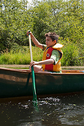 North America, United States, Washington, Bellevue,boy (age 9) kayaking in Mercer Slough Nature Park  MR
