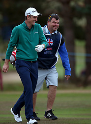 Justin Rose with his caddie during day two of the British Masters at Walton Heath Golf Club, Surrey.