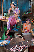 A fish seller in a market in Siem Reap, Cambodia. PHOTO TIAGO MIRANDA