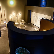 Smithsonian National Museum of African Art  Cosmos Stella Arts Exhibit. View from above of part of the African Cosmos: Stella Arts exhibit at the Smithsonian African Art Museum. The Smithsonian National Museum of African Art was opened at its current location in 1987 as a mostly underground facility behind the Smithsonian Castle on Washington DC's National Mall. It is dedicated to ancient and contemporary African art.