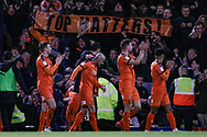 Luton Town players applaud their fans in front of a Top Hatters banner, as they go top of the league, during the EFL Sky Bet League 1 match between Southend United and Luton Town at Roots Hall, Southend, England on 26 January 2019.