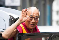 """London, September 21st, 2015. The Dalai Lama, who is on a visit to Britain, arrives amid anti-discrimination protests by Shugden Buddhists, at the Lyceum Theatre in Covent Garden to host """"An Afternoon with the Dalai Lama and Friends""""."""