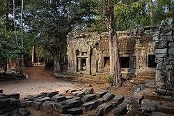Early morning light seeps into the site of Banteay Kdei west entrance