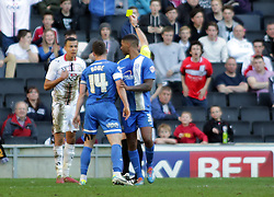 Milton Keynes Dons' Dele Alli is booked for diving - Photo mandatory by-line: Joe Dent/JMP - Mobile: 07966 386802 15/03/2014 - SPORT - FOOTBALL - Milton Keynes - Stadium MK - MK Dons v Peterborough United - Sky Bet League One