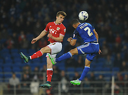 Joe Bryan of Bristol City challenges for the header with Lee Peltier of Cardiff City - Mandatory byline: Dougie Allward/JMP - 07966 386802 - 26/10/2015 - FOOTBALL - Cardiff City Stadium - Cardiff, Wales - Cardiff City v Bristol City - Sky Bet Championship