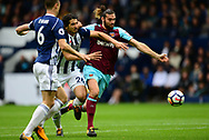 Andy Carroll of West Ham Utd battles with Ahmed Hegazi of West Bromwich Albion. Premier league match, West Bromwich Albion v West Ham United at the Hawthorns stadium in West Bromwich, Midlands on Saturday 16th September 2017. pic by Bradley Collyer, Andrew Orchard sports photography.