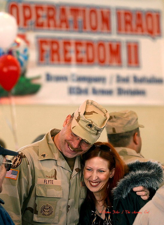 HOMETOWN, Pa - Soldiers from Bravo Co., 2nd Battalion, 103rd Armor Div., based at the National Guard armory on Ardmore Drive returned to their barracks from Iraq via Ft. Dix, New Jersey Saturday, March 5, 2005, They were greeted by thousands of family and friends. Here, Sgt. Dean Flyte of BETHLEHEM hugs his wife Sheri Flyte on his arrival. He hunted for weapons of mass destruction in Iraq.  SEE KIRK JACKSON STORY   (DONNA FISHER/TMC)