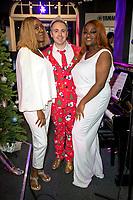 Hannah Long, and John Galea performing  festive songs at the Yamaha Store in Soho, London.