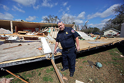 24 February 2016. Schexnaydre St, Convent, Louisiana.<br /> Fire marshal Mr Aucoin surveys scenes of devastation following a deadly EF2 tornado touchdown. 2 confirmed dead. <br /> Photo©; Charlie Varley/varleypix.com
