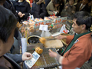traditional rice cookies made at a outdoor fair near the Asakusa Kannon Temple Tokyo