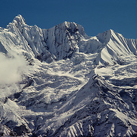 Himalayan peaks tower above the Annapurna Sanctuary in Nepal.