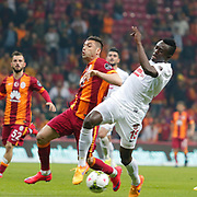 Galatasaray's Burak Yilmaz (L) and Gaziantepspor's Gbenga Arokoyo (R) during their Turkish Super League soccer match Galatasaray between Gaziantepspor at the AliSamiYen Spor Kompleksi TT Arena at Seyrantepe in Istanbul Turkey on Sunday, 26 April 2015. Photo by Kurtulus YILMAZ/TURKPIX