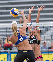 31-07-2014 AUT: FIVB Grandslam Volleybal, Klagenfurt<br /> Marleen van Iersel of Netherlands (F) in action against Lena Maria Plesiutschnig (H) during women's main draw match<br /> ***NETHERLANDS ONLY***