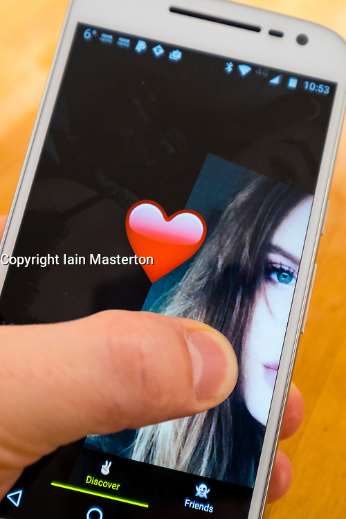 Detail of Yellow teenage dating app on smart phone