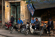 Scooter drivers await business, old quarter of Hanoi.