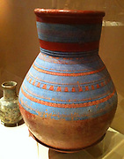 Large jar from the 18th Dynasty. Made during the reign of Akhenaten. Circa 1353-1336 B. Made from fired clay and polished ochre slip. Painted with blue red and black paint. Probably from Amarna.