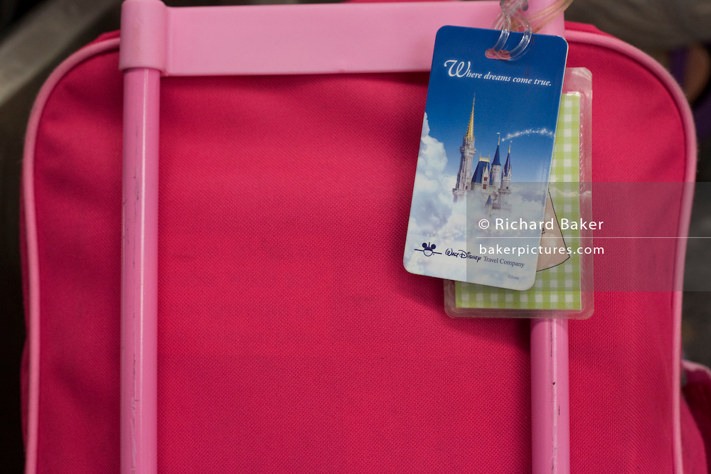 Childrens' Disney-themed pink baggage in check-in areas at Heathrow Airport's Terminal 5.