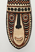 Papua New Guinea, Sepik river, there is a tradition of wood carving mask representing ancestor spirits. On white Background
