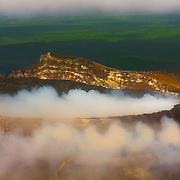 Kīlauea is a currently active shield volcano in the Hawaiian Islands, and the most active of the five volcanoes that together form the island of Hawaii I flew over the mighty volcano by helicopter.