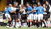 Fotball<br /> Treningskamp England<br /> <br /> Foto: Frances Leader, Digitalsport<br /> NORWAY ONLY<br /> <br /> Fulham v Rangers<br /> Pre-season friendly<br /> 24/08/2004.<br /> <br /> Rangers Stephen Klos (captian and goalie) and Jean-Alain Boumsong hold Fulhams Collins John away from Rangers Zurab Khizanishvili