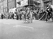 Finish of Dublin City Marathon .25/10/1982  Radio 2, Dublin City Marathon..1982.25.10.1982.10.25.1982.25th October 1982..The Radio 2 sponsored Dublin City Marathon finish at St Stephens Green Dublin..The overall winners were:Men, Gerry Kiernan,Listowel, Kerry. Women, Debbie Mueller,U.S.A. and the first wheelchair competitor Michael O'Rourke..Using just hand power Michael O'Rourke approaches the finish line cheered on by the crowd.