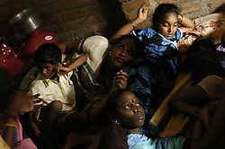 """G. Velvish,27, left, and P. Saranya,20, relax  with her adopted son and nephew Ajit,10, and niece at her hut in Chennai, India. <br /> As transgenders,""""hijras"""" in local terms, are acutely marginalized in Indian society, the major earning avenues for them are sex work, begging and performing at rituals."""