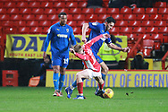 AFC Wimbledon defender Will Nightingale (5) taking on ac12z during the EFL Sky Bet League 1 match between Charlton Athletic and AFC Wimbledon at The Valley, London, England on 15 December 2018.