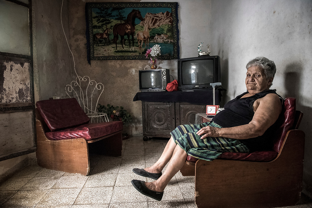 Nies Rodriguez, 80, poses for a photo January 4 2015 in the house she's lived in for 40 years in Central Havana, Cuba. The United States announced last month that it will end its fifty-year trade embargo with Cuba and move to normalizing relations. Cuba's budding private sector is strengthening, but still has a long way to go to prepare for the expected stream of tourists. Photo Ken Cedeno