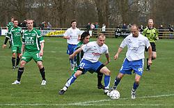 FODBOLD: Nikolai Winther og Allan Achütt (Rishøj) lukker af for Oliver Goreng (Helsingør) under kampen i Kvalifikationsrækken, pulje 1, mellem Rishøj Boldklub og Elite 3000 Helsingør den 9. april 2007 på Rishøj Stadion. Foto: Claus Birch