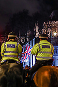 January 31, 2020, London, England, United Kingdom: Police observe as Pro-Brexit supporters celebrate in London on Jan. 31, 2020 - as the UK leaves the European Union with 51. 9% of the UK population that voted to leave the EU in a referendum in June 2016. (Credit Image: © Vedat Xhymshiti/ZUMA Wire)