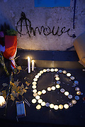 LOVE, Amour and PEACE symbol. Place Republique, Parisians pay hommage to those killed and wounded in the Terrorist attacks<br /><br />The Day after the terrorist jihadi attacks. Bullet holes and blood, mourning homage and cleaning up. Aftermath of deadly Paris terrorist attacks. Saturday 14th November 2015<br /> <br /> Eight terrorists dead and some 128 people killed at Stade de France, Bataclan concert Hall, Belle Equipe Restaiurant, Rue Fontaine au Roi, Two hundred people have been injured, 80 of them seriously.