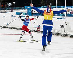 February 17, 2018 - Pyeongchang, South Korea - Ragnhild Haga, foreground, jumps for joy as her teammate MARIT BJOERGEN of Norway crosses the finish line winning them a Gold Medal during the Ladies' 4 x 5km Relay at the Alpensia Cross-Country Center during the 2018 Pyeongchang Winter Olympic Games. (Credit Image: © Daniel A. Anderson via ZUMA Wire)