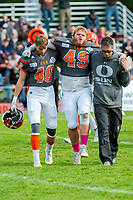 KELOWNA, BC - OCTOBER 6: Athletic therapist Roy Gillespie and Liam Johnstone #40 assist Dawson Puk #49  of Okanagan Sun off the field against the VI Raiders at the Apple Bowl on October 6, 2019 in Kelowna, Canada. (Photo by Marissa Baecker/Shoot the Breeze)