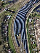 Nederland, Noord-Holland, Amsterdam; 23-03-2020; Carolina MacGillavrylaan / Kruislaaan, Rietlanden, emplacement van de NS. Omdat de NS een speciale basisdienstregeling ingevoerd heeft ivm de Corna-crisis zijn veel treinen 'geparkeerd' op opstelsporen. Op de foto intercity treinen.<br /> Railway yard of the NS. Because the NS has introduced a special basic timetable in connection with the Corna crisis, many trains have been 'parked' on sidings.<br /> <br /> luchtfoto (toeslag op standaard tarieven);<br /> aerial photo (additional fee required)<br /> copyright © 2020 foto/photo Siebe Swart