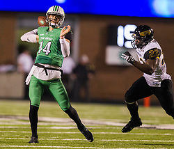 Oct 9, 2015; Huntington, WV, USA; Marshall Thundering Herd quarterback Chase Litton throws out of the pocket during the second quarter against the Southern Miss Golden Eagles at Joan C. Edwards Stadium. Mandatory Credit: Ben Queen-USA TODAY Sports