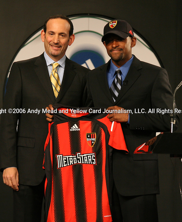 20 January 2006: MLS Commissioner Don Garber and UCLA's Marvell Wynne (r) who was taken by the MetroStars with the first pick of the first round. The 2006 MLS SuperDraft was held in the Pennsylvania Convention Center in Philadelphia, PA during the National Soccer Coaches Association of America's annual convention.
