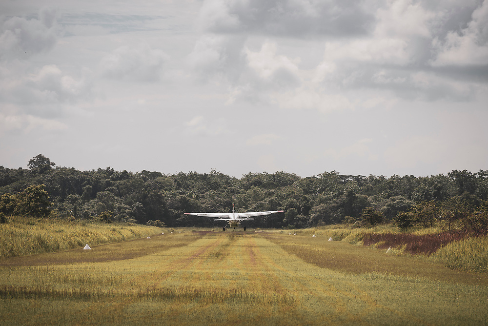 A Cessna 208 Caravan, part of the Missionary Aviation Fellowship fleet, takes off from a bush airstrip in Tamo (Likan) in the East Sepik Province of Papua New Guinea. (June 24, 2019)