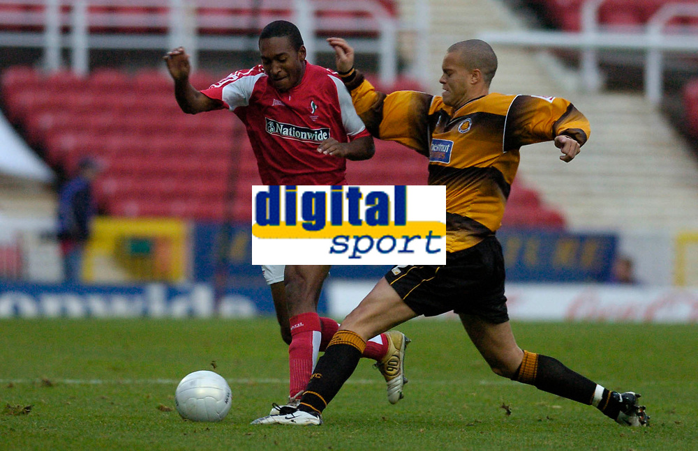 Photo: Alan Crowhurst.<br />Swindon Town v Boston Utd. The FA Cup. 05/11/2005.<br />Ricky Shakes (L) of Swindon takes on Lee Canoville.