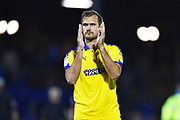 James Hanson (18) of AFC Wimbledon applauds the travelling fans at full time after Wimbledon lost 2-0 to Bristol Rovers during the EFL Sky Bet League 1 match between Bristol Rovers and AFC Wimbledon at the Memorial Stadium, Bristol, England on 23 October 2018.