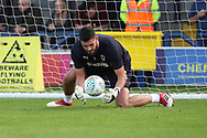 AFC Wimbledon goalkeeper Tom King (1) warming up during the EFL Carabao Cup 2nd round match between AFC Wimbledon and West Ham United at the Cherry Red Records Stadium, Kingston, England on 28 August 2018.