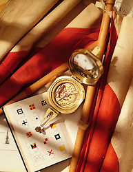Compass with nautical signal flags and flag book compass