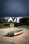 """Boat pulled up on the beach, Brignogan Plage, Brittany This mage can be licensed via Millennium Images. Contact me for more details, or email mail@milim.com For prints, contact me, or click """"add to cart"""" to some standard print options."""