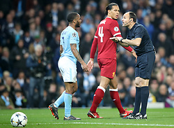 Referee Antonio Miguel Mateu Lahoz speaks with Manchester City's Raheem Sterling during the UEFA Champions League, Quarter Final at the Etihad Stadium, Manchester.