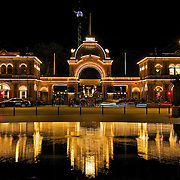Lights and reflections at night at the entrance to Tivoli Gardens in Copenhagen, one of the oldest amusement parks in the world