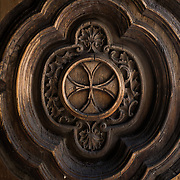 The pattern on a carved solid wood door at Iglesia de la Santisima Trinidad in Mexico City, Mexico. Iglesia de la Santisima Trinidad translates as Church of the Holy Trinity.