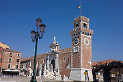 The Torri dell Arsenale in Venice, Italy. The Venetian Arsenal (Torri dell'Arsenale) played an important role in Venice's history.  The facility, which is identifiable from its twin towers, is said to date back to the 12th century.<br /> Many of the Venetian Republic's commercial and military vessels were built and maintained here.