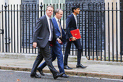 © Licensed to London News Pictures. 16/10/2019. London, UK. Secretary of State for Scotland ALISTER JACK (L),  Foreign Secretary DOMINIC RAAB (C) and Chief Secretary to The Treasury RISHI SUNAK  (R)  arrives in Downing Street to attend the weekly cabinet meeting. This week's cabinet meeting was postponed by one day on Tuesday 15 October amid a final push for a Brexit agreement that can be sealed in time for the European Council summit in Brussels on Thursday and Friday. Photo credit: Dinendra Haria/LNP